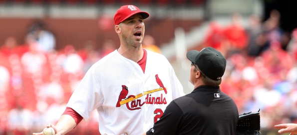 St. Louis Cardinals starting pitcher Chris Carpenter is kept away from Houston Astros Carlos Lee by umpire Marvin Hudson after the two have words in the third inning at Busch Stadium in St. Louis on May 13, 2010. Order was restored after the two benchs cleared.   UPI/Bill Greenblatt
