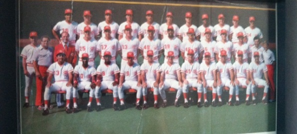 Cobb, in the red jacket, is pictured here with the 1985 Reds, managed by Pete Rose.