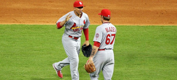 Jun 25, 2013; Houston, TX, USA; St. Louis Cardinals center fielder Jon Jay (19) celebrates with relief pitcher Michael Blazek (67) after defeating the Houston Astros 13-5 at Minute Maid Park. Mandatory Credit: Troy Taormina-USA TODAY Sports
